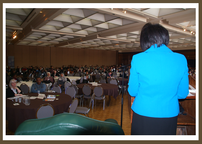 Daisy Wright delivering a keynote to a group of new immigrants in Windsor, Ontario.